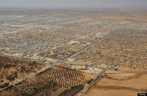 An aerial view shows the Zaatari refugee camp on July 18, 2013 near the Jordanian city of Mafraq, some 8 kilometers from the Jordanian-Syrian border. The northern Jordanian Zaatari refugee camp, now home to 160,000 Syrians, equal in size to what would be Jordan's fifth-largest city. AFP PHOTO/MANDEL NGAN/POOL        (Photo credit should read MANDEL NGAN/AFP/Getty Images)