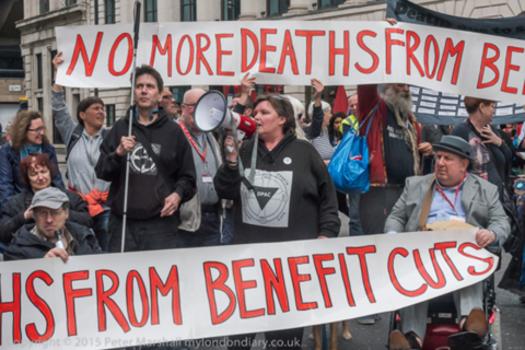 London, UK. 19th May, 2016. Paula Peters speaks at the road  block of Tottenham Court Rd by delegates at the TUC disabled workers conference led by activists from Disabled People Against Cuts (DPAC), Mental Health Resistance Network (MHRN) and Winvisible (Women with visible and invisible disabilities) calling for an end to government benefit cuts which have led to the deaths of many disabled people - including 2 DPAC members the previous day. There were speeches and chanting as they blocked traffic, with pedestrians gathering and some drivers hooting in support. Peter Marshall/Alamy Live News